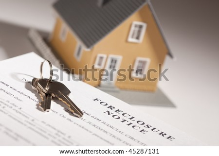 Foreclosure Notice, House Keys and Model Home on Gradated Background with Selective Focus. - stock photo