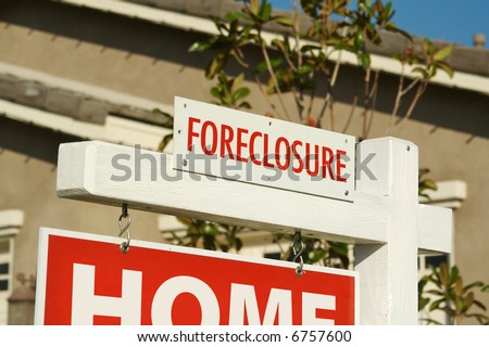 Foreclosure Real Estate Sign in Front of House. - stock photo