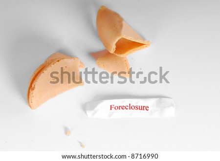 Foreclosure written in red on fortune inside chinese cookie - stock photo