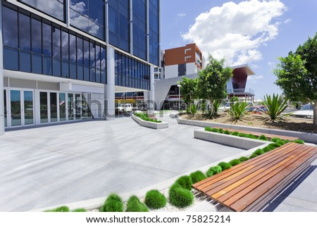Forecourt of Modern Corporate Building with bench - stock photo