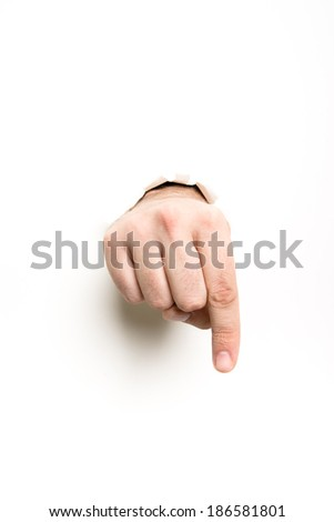 forefinger forward through the paper hole on white background