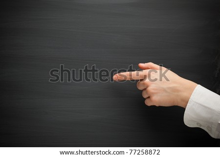 forefinger point at the blank blackboard