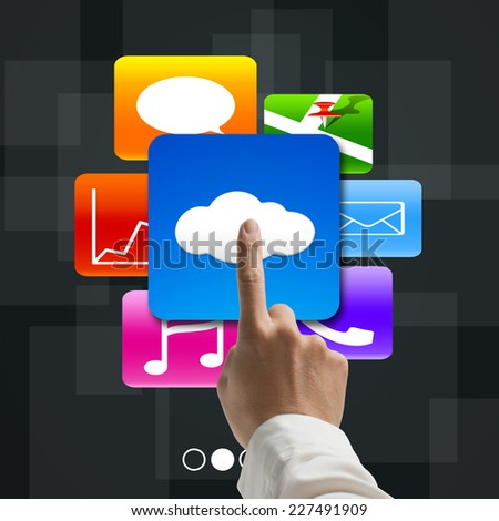 forefinger pointing at cloud computing with colorful app icons on tech background - stock photo