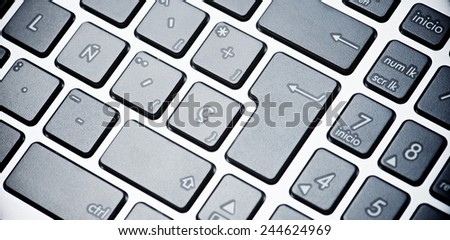 Forefront of a gray laptop keyboard. - stock photo
