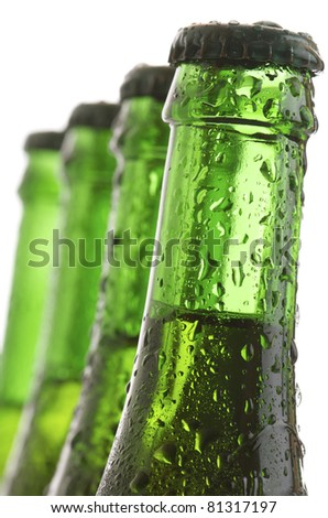 forefront of  a green bottles of beer - stock photo