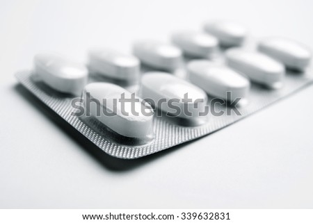 Forefront of a white medicine pills in blister pack.