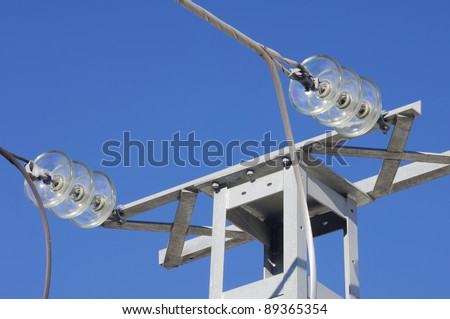 forefront of electrical insulators of electric power lines - stock photo