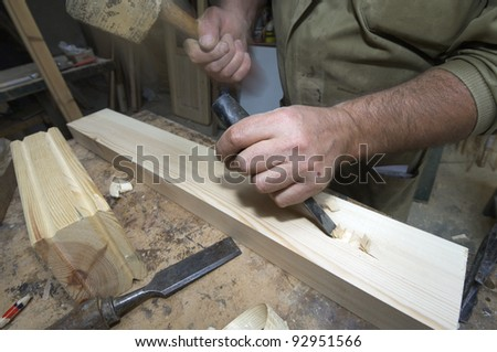 forefront of the hands of a carpenter working - stock photo