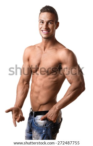 Forefront young man with well trained body, abs and pecs and wearing a denim trousers - stock photo
