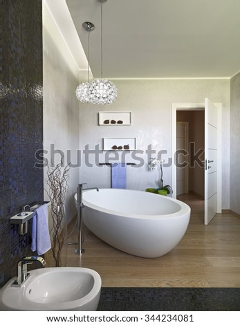 foreground of a bathtub in the modern bathroom which floor is made of wood - stock photo