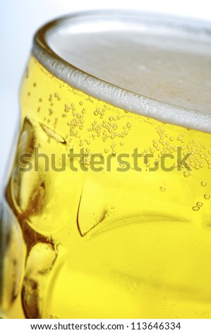 foreground of a refreshing pitcher of beer