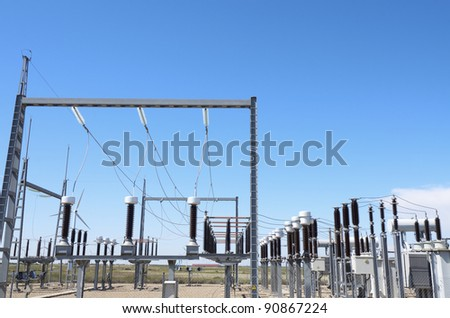 foreground of  an electrical substation with blue sky - stock photo