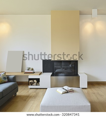 foreground of fireplace in the modern living room with wood floor - stock photo