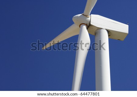 foreground of the top of a windmill for renewable electric energy production - stock photo