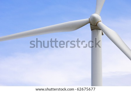 foreground of the top of a windmill producing electricity - stock photo