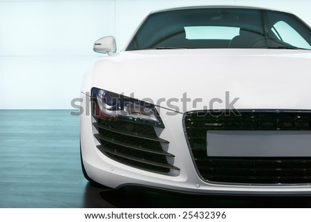 Foreground of white luxury sportcar  exhibition - stock photo