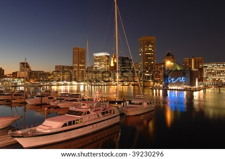 foreground of yachts with the Baltimore skyline at dusk behind