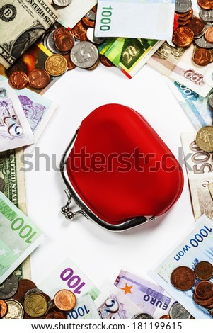 Foreign coins and banknotes frame with red purse. Money background - stock photo
