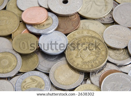 Foreign coins from Mexico, Guatemala, Canada and others - stock photo