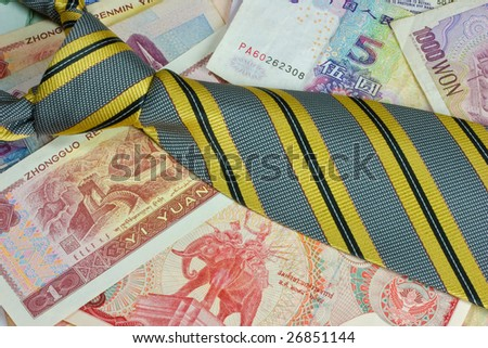 Foreign currency and a tie - stock photo