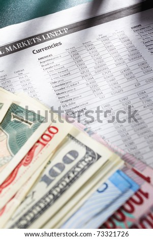 Foreign exchange sheep paper with money from different countries on edge - stock photo