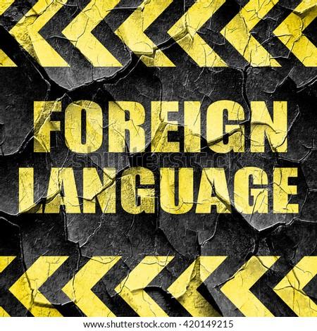 foreign language, black and yellow rough hazard stripes - stock photo
