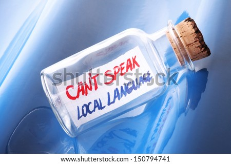 "Foreign language learning concept. Message in a bottle with text ""Can't speak local language""  - stock photo"