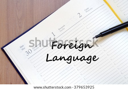 Foreign language text concept write on notebook with pen