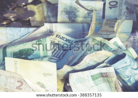 Foreign money collage background. Bank notes from different countries, vintage effect - stock photo