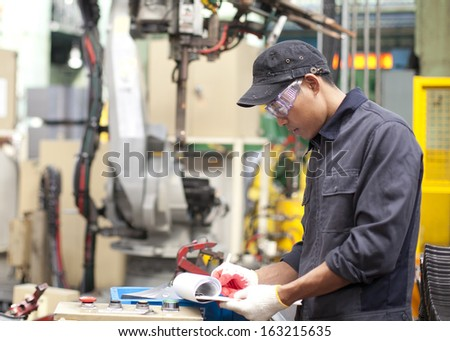 Foreman auditing number in metalworking - stock photo
