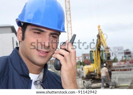 Foreman communicating via radio - stock photo