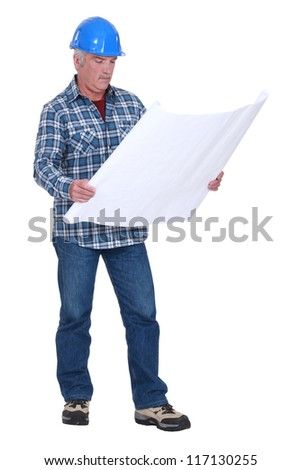 foreman consulting blueprints - stock photo