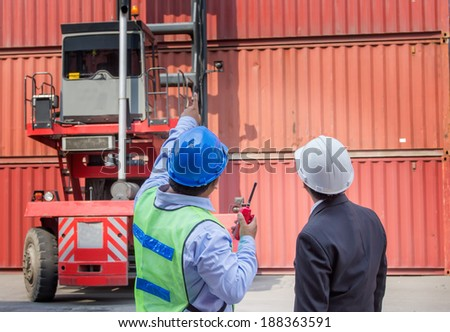 foreman control forklift handling follow order from his manager for move the container box loading - stock photo