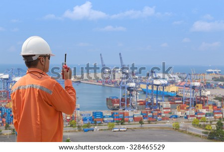 foreman control in connection with Cargo freight ship at harbour - stock photo