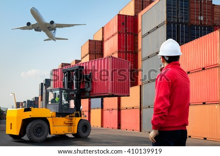 Foreman control loading Containers box from Cargo freight ship, Warehouse shipping transportation concept.