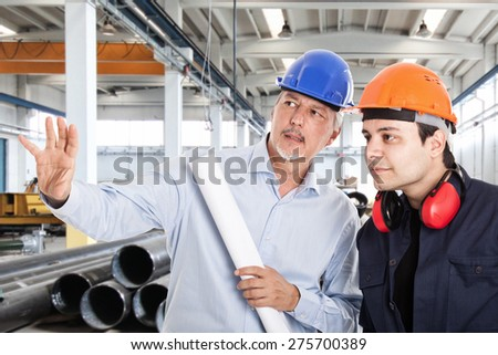 Foreman explaining a job to a worker - stock photo