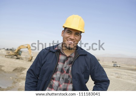 Foreman in hard hat at construction site - stock photo
