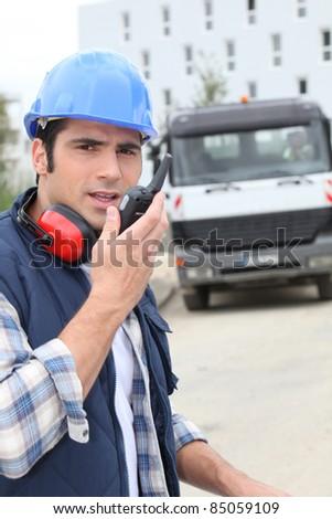 Foreman overlooking work site - stock photo