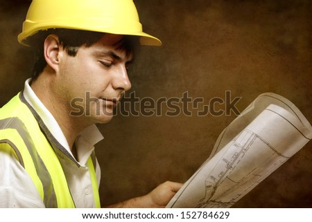 Foreman, project manager or a builder with architectural site plans