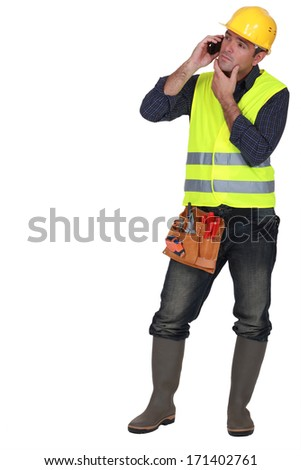 Foreman thinking during phone call - stock photo