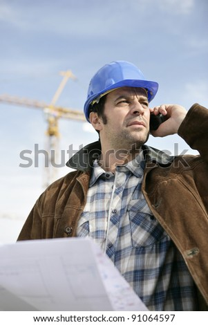 Foreman with a laptop and phone - stock photo