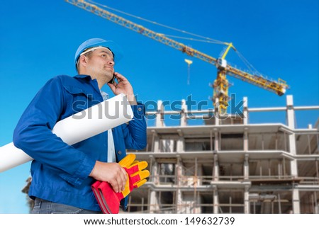 Foreman with blueprints at construction site