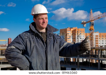 Foreman worker giving okay sign hand gesture at building area - stock photo