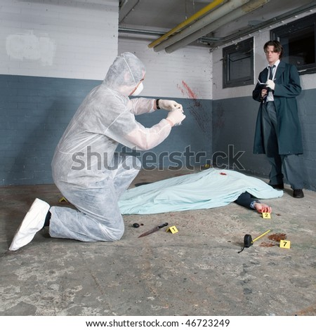 Forensic expert bagging evidence at a crime scene whilst a police inspector is taking notes around the corpse of a murdered businessman - stock photo