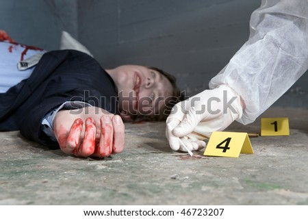 Forensic expert collecting evidence at the crime scene of a murdered businessman - stock photo