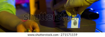 Forensic science technician working on a crime scene - stock photo