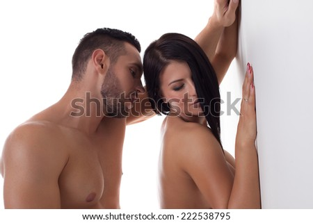 Foreplay of beautiful young couple, close-up - stock photo