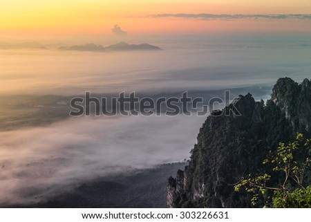 Forest and Fog in the Morning at Wat Prajomklao Rachanusorn temple on top of mountain at Lampang, North of Thailand.