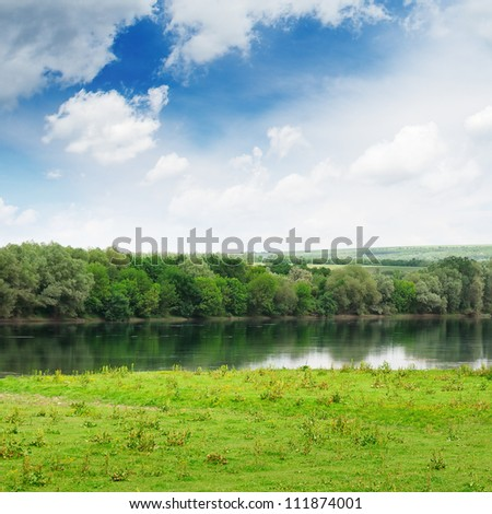 forest and meadow on the banks of the River - stock photo