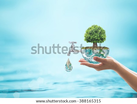 Forest big rain tree arbor planting on blue aqua world on women's human hand Water drop running from faucet tap Saving aqua reforestation conceptual csr esg idea Element of the image furnished by NASA - stock photo